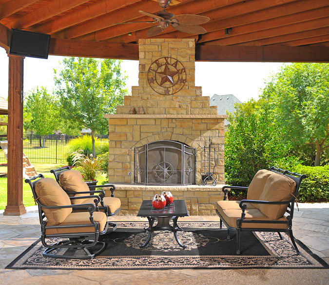 Southwest Fence & Deck Covered Patio and Stone Fireplace